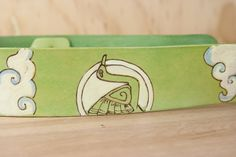This strap was custom made to coordinate with a seafoam green guitar - the Japanese inspired crane and flowers add the right balance of pattern to this totally unique guitar strap!