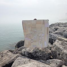 """Artist Heidi Parkes with her quilt, """"Lots of Cream, Lots of Sugar.""""  Along the Milwaukee lakefront, near her home."""