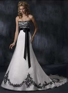 Love this dress. Love the black and white idea! My wedding will be black, white, hot pink and lime green.