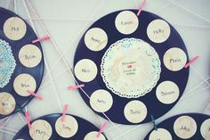 Retro #Wedding Table Plan Idea! Gather old records of your favorite #tunes and attach name cards around
