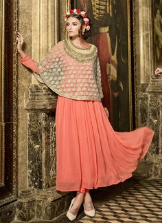Be an angel and create a smashing impact on everyone by wearing this orange georgette anarkali salwar kameez. The lovely embroidered work throughout the attire is awe inspiring