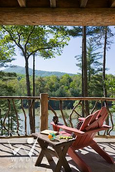 Back porch with a gorgeous view..log cabin design ideas and decor, adirondack style chair, beautiful mountain view