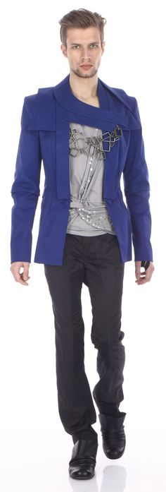 Jacket ( cotton), draped top ( cotton jersey),     trousers ( wool & satin), shoes ( leather)