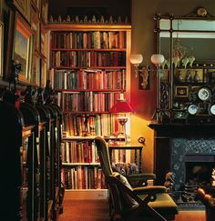 Books reside in bookcases (with Gothic cornice ornament) and in display cases in this home library in Great Britain. (Photo: Huntley Hedworth)
