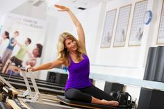 Stretching on the Reformer at YMCAfit, our LTC in the UK