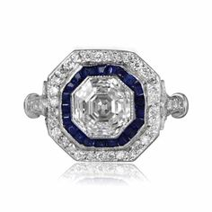 Take a look at this rare and stunning Asscher Cut Diamond and Sapphire Engagement Ring set in platinum, diamond and sapphire mounting.