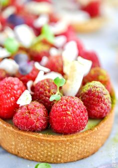 A delightful Coconut Matcha Ganache Tart with layers of silky green tea coconut ganache, raspberries and toasted coconut in a homemade sweet pastry. Who's ready to cheer up their winter-weary tastebuds? This Coconut Matcha Ganache Tart will certainly infuse these dog days of winter (is that even a term?) with some much needed colour and flavour. I...