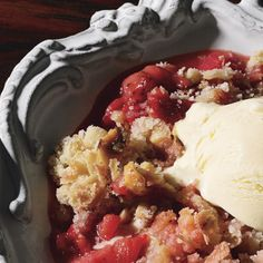 The crumble is the British version of the American crisp. This one features the classic combination of tart rhubarb and sweet strawberries, topped with a crunchy oat-and-hazelnut streusel. A scoop of ice cream is the perfect finishing touch. Just Desserts, Delicious Desserts, Dessert Recipes, Yummy Food, Sweet Desserts, Crumble Recipe, Crisp Recipe, Strawberry Rhubarb Crumble, Strawberry Desserts