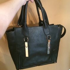 """Segolene Paris black vegan leather tote Black vegan leather. High quality handbag. Two compartments inside, with pockets. About 13"""" by 16"""". Big enough to hold a laptop. Removable shoulder strap included. No trades Segolene Paris Bags Totes"""