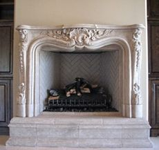 Fireplace / mantle made of glass fiber reinforced concrete (GFRC). Known for its light weight, high strength and durability, it can be moulded and finished to look like hand-carved marble or limestone. ~ Standout fireplace designs.com