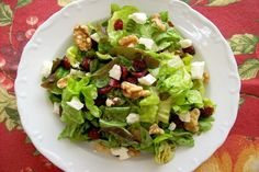 Healthy fall dinner - cranberry, (im adding chicken), and walnut salad with feta.