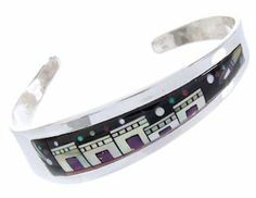 """Sterling Silver And Multicolor Jewelry Native American Village Or Pueblo Design Cuff Bracelet YS67352 SilverTribe. $329.99. MEASUREMENTS: The inner bracelet circumference measures approximately 5-5/8"""", plus a 1"""" opening, and 5/8"""" at widest point.. Southwestern Jewelry. Sterling Silver And Multicolor Jewelry Native American Village Or Pueblo Design Cuff Bracelet YS67352. MATERIALS: Sterling Silver, Turquoise, Magenta Turquoise, Black Jade, Blue Opal, Red Oyster Shel..."""