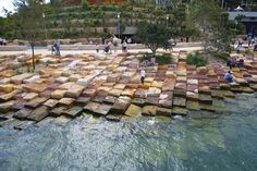 """The foreshores of the reserve have been formed in a style that represents the natural formation known on the coast as """"tessellated pavement."""""""