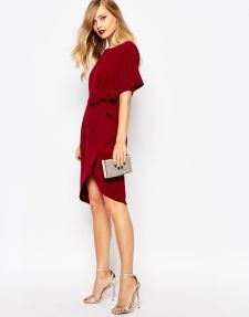 This red dress is a classic silhouette. The hemline is perfect for fall.
