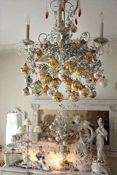 white chandelier with silver and gold christmas balls