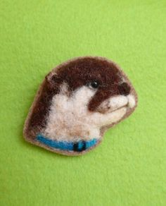 Otter Brooch needlefelted