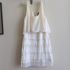 AMERICAN EAGLE- Fringed Dress with Blouse Top Super cute fringed white American Eagle dress. A little short than knee length. The blouse is attached to dress. Very flattering and fun dress. Off-white color. American Eagle Outfitters Dresses Midi