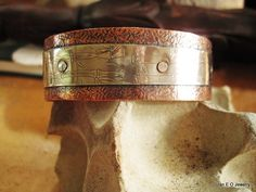 German silver etched with bamboo stalks has been riveted to textured copper. This cuff has an organic tribal design and the metals are believed to have healing properties. Wearing German silver encourages creativity and a lightness of spirit. Copper can help you improve your awareness and expand your consciousness. It's particularly useful in strengthening bonds between people