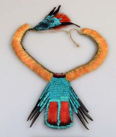 Brazil ~ Para State | Necklace ~ pu;ir ~ from the Ka'apor people.  Macaw and toucan feathers, cotinga scalps, tree gum and cordage.  ca. 1955 - 62.
