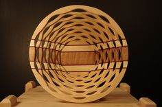 Segmented bowl made from birch, curly maple, purple heart and ash.