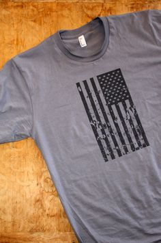 Beautifully designed Old Glory Still Waves Patriotic T-Shirt for men in a clear, cool, urban style. The American flag, Old Glory, standing tall and flying free over American soil is the symbol of our