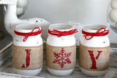 This is a custom designed & hand-painted set of 3 pint size Mason Jars wrapped in burlap to spell out JOY. Each jar is hand painted with Pure White, lightly distressed and sealed. Also each jar is then wrapped with a hand painted letter on the burlap. Centerpiece Christmas, Diy Christmas Decorations Easy, Christmas Mason Jars, Christmas Projects, Holiday Crafts, Decoration Crafts, Christmas Ideas, Farmhouse Christmas Decor, Rustic Christmas