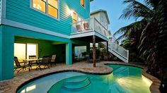 303-A 61st St is an elegant and tropical get away with (4) bedrooms, and (3.5) baths.