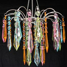 Google Image Result for http://chandelierswithshades.com/wp-content/uploads/2011/03/Acrylic-Chandelier1.jpg