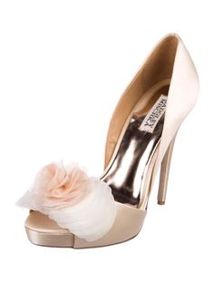 af011f778316 Peach satin Badgley Mischka peep-toe pumps with floral accent at tops and  covered heels. Includes dust bag.