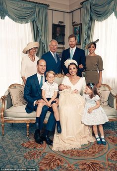 A more intimate family portrait shows a beaming Prince George and Princess Charlotte gazin...