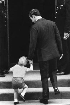 Prince William clings to his father, Prince Charles, as they walk up the stairs of St. Mary's Hospital to see Princess Diana and Prince Harry in 1984.