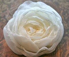 Ivory rose hair flower by Mermaiden Creations. Win this for free by entering the giveaway: http://www.bridesmaidsandweddings.com/2012/07/giveaway-alert-mermaiden-creations/