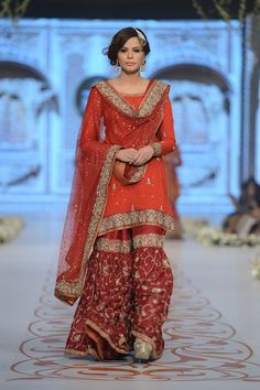 I like the length of kameez, material leg band on sharara