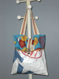 This tote uses house wrap, cotton fabric, webbing, and ribbon for accents.