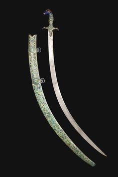 AN INDO-PERSIAN ENAMELLED SWORD AND SCABBARD WITH WATERED-STEEL BLADE, SIGNED BY KALB 'ALI, PERSIA, DATED 1081 AH/1670 AD, AND INDIA, 18TH CENTURY the curved watered-steel blade with straight edge, the silver-gilt hilt with the pommel and quillons each in the form of a ram's head, densely decorated in champlevé translucent and opaque enamels with floral panels delineated by bands with fish or duck against a green background