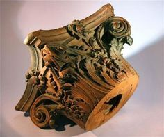 The top of a wooden Roman corinthian column capital