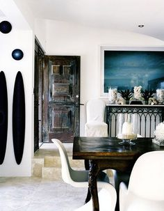 panton chairs and wood table    black white and blue