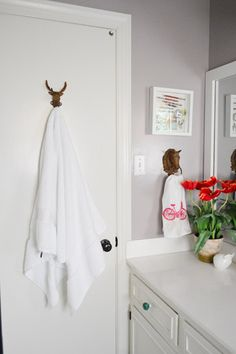 Use old secondhand metal animal hooks in a bathroom for towels. Love the idea