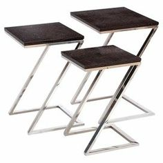 """Set of three nesting tables with croc-style tops and open metal frames.  Product: Small, medium and large nesting tableConstruction Material: Wood, metal and faux leatherColor: Silver and brownDimensions: 24"""" H x 18"""" W x 16"""" D (large)"""