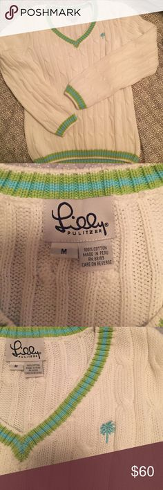 Lilly Pulitzer cable knit sweater White with green and aqua trim along the collar, sleeve trim, and waist trim! A true Lilly classic! Excellent condition! Lilly Pulitzer Sweaters V-Necks