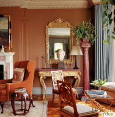 Timothy Whealton ~ In a New York townhouse's living room, the neoclassical side table is from the collection of John Hobbs. A pair of Russian chairs are circa 1800.