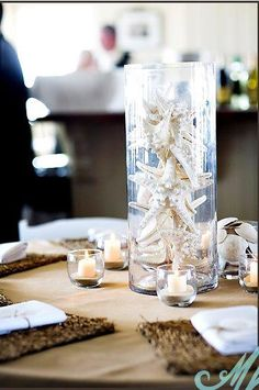 with the place mats this glass vase idea is starting to grow on me - would add varying colors of starfish or coral to match color scheme
