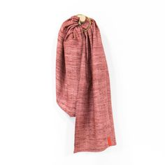 Sakura Bloom Rosewood -  Raw silk fibers spun and then handloomed to create a cloth full of charm and texture, and with incredible support. Crafted from a single layer of raw handloomed silk. One size, adjustable baby ring sling. Newborn-35lbs. sakurabloom.com