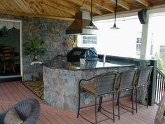 Custom Outdoor Kitchen with Seating and Patio Covering