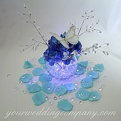 Add some sparkle and bling to your wedding reception tables with these 6-carat acrylic diamonds.  A unique table confetti for a diamond-themed wedding. www.yourweddingcompany.com