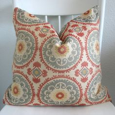 ONE new 20x20 suzani, light neutral gold, light blue, light red, pillow cover, throw pillow,  decorative pillow. $50.00, via Etsy.