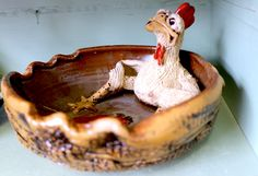 This hilarious handcrafted bowl with sitting chicken will be sure to bring a little bit of humor into your home. -- Find this piece at Cranberry Corners in Downtown Dahlonega! | cranberrycorners.blogspot.com