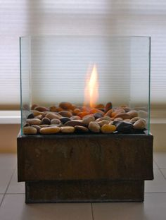 No room for a large fire pit? Create your own personal one out of a metal planter and cheap glass frames.