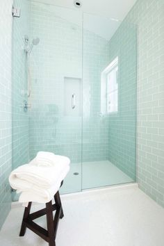 Absolutelygorgeous contemporary glass tile bathroom decoratively hexagon tile flooring with subway tile with polished chrome paired glass subway tile shower paired white hex flooring. Clear glass shower doors bathroom collection of clear glass, glass sub Glass Tile Bathroom, Blue Glass Tile, Blue Subway Tile, Glass Subway Tile, Glass Shower, Modern Bathroom, Small Bathroom, Glass Tiles, Sea Glass