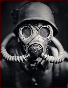 WWII German Soldier in A Gas Mask. Hitler should be given credit for seeing that gas was not used during the European war due to his own disgust with chemical warfare. He had been a gas casualty during the First World War. Gas Mask Art, Masks Art, Gas Masks, Gas Mask Drawing, Drawing Art, Black And White Face, Sucker Punch, War Photography, Photography Ideas